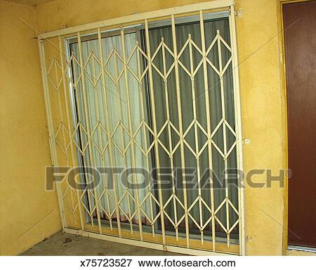 Picture Of Security Gate Across Sliding Glass Door X75723527