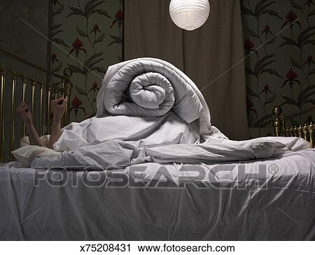 Person Hiding Under Covers On Bed Stock Photography X75208431