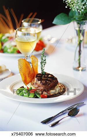 Steak entree at fine dining restaurant Stock Photograph ...