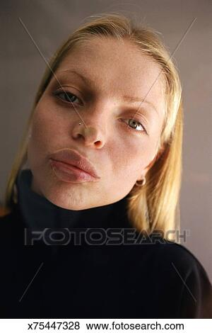 Lips Against The Glass.Woman Pressing Lips Against Glass Stock Photo