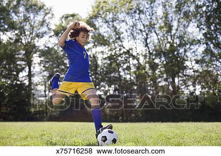 pictures of boy kicking soccer ball x75716258 search stock photos