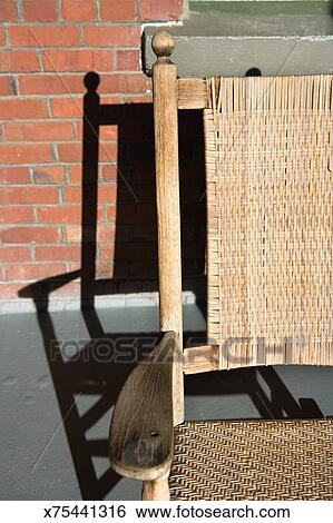 Remarkable Rocking Chair And Shadow On Porch Stock Photograph Customarchery Wood Chair Design Ideas Customarcherynet
