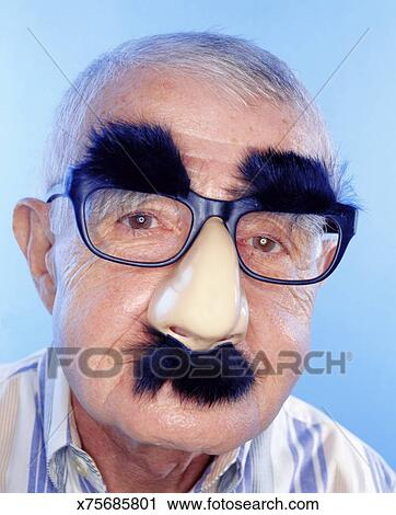 59441ea9816 Stock Photography of MATURE MAN WITH NOVELTY FAKE NOSE AND GLASSES ...