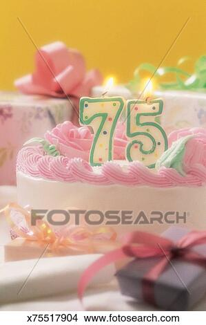 Birthday Cake With Number 75 Candle On It