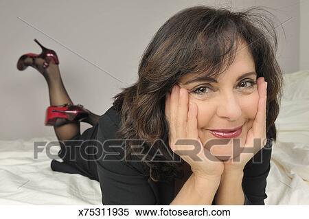 Mature in high heels