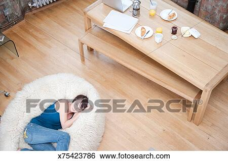 Marvelous Woman On Furry Bean Bag Chair In Living Room Stock Forskolin Free Trial Chair Design Images Forskolin Free Trialorg