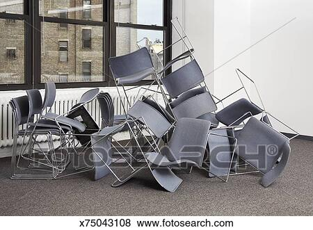 Admirable Pile Of Chairs On Floor In Middle Of Room Stock Photo Spiritservingveterans Wood Chair Design Ideas Spiritservingveteransorg