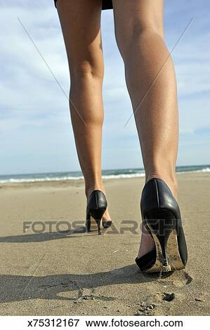Picture Woman Walking On Beach With High Heels Fotosearch Search Stock Photography