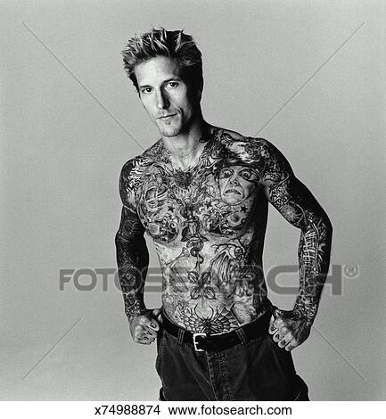 Stock Photo Of Man With Tattoos On Chest And Arms Portrait Bw