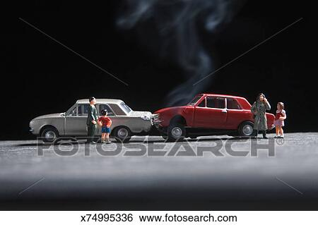 Stock Images Of Model Family At The Scene Of A Toy Car Crash