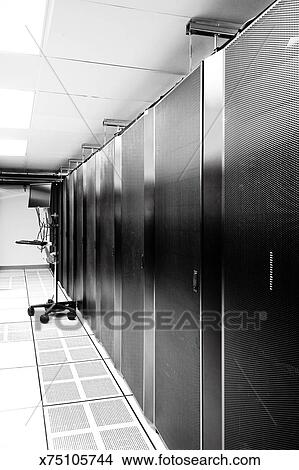 stock photo of computer server room aisle with crash cart x75105744