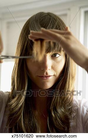 Stock Photography Of Woman Cutting Hair With Scissors Close Up