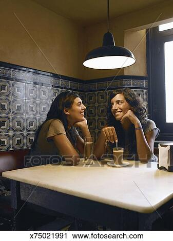 Stock Photography of Two women at dining table 3094e263c