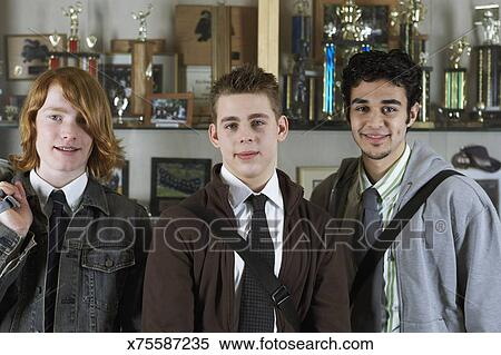 Stock Image Of Teenage Boys By Trophy Case At School X75587235