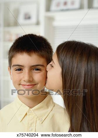boy kissing his girl