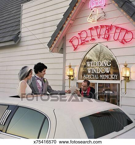 Newlyweds At Drive Thru Wedding Chapel
