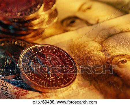 German Currency One Mark Coins On Fifty Banknotes Close Up
