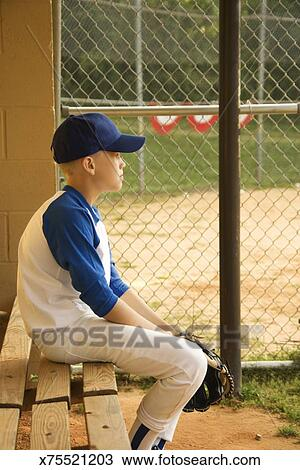 Boy Sitting On Bench In Baseball Dugout Stock Image X75521203