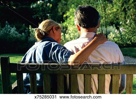 Sensational Mature Couple Sitting On Wooden Bench Rear View Stock Image Ocoug Best Dining Table And Chair Ideas Images Ocougorg