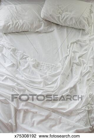Stock Photo   Unmade Bed With White Sheets. Fotosearch   Search Stock  Photography, Print