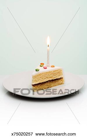 Picture Of Slice Of Birthday Cake With Candle Sticking Out Of