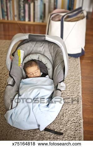 Newborn Baby Boy In Car Seat Carrier Arriving Home