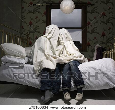 Stock Photo Of Couple Hiding Under Sheet On Bed X75100634 Search
