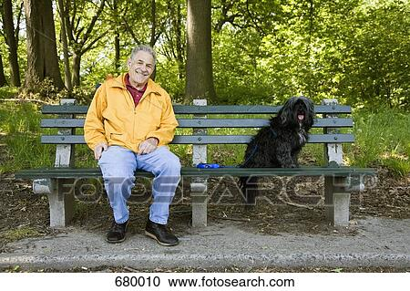 A Man Sitting With His Dog On A Park Bench Prospect Park Brooklyn