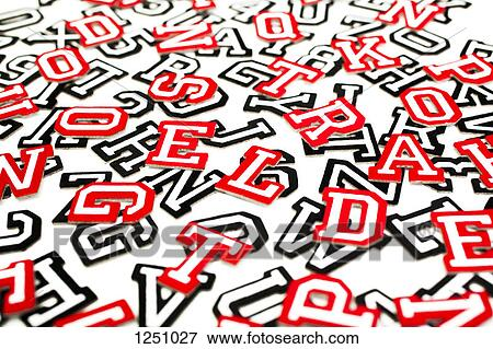 Picture of A bunch of varsity font sticker letters and numbers in