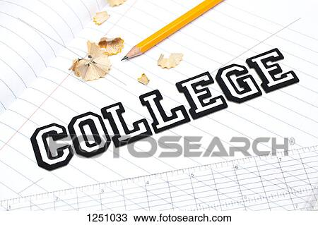 Varsity font stickers spelling out College atop a lined paper notebook with  ruler and pencil Stock Image