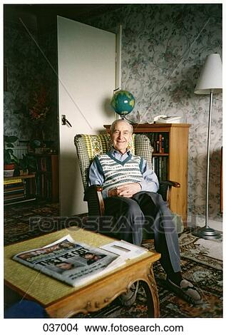 Stock Photo Of An Old Man Sitting In A Rocking Chair In His Living