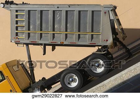 Dump Truck Dumping Concrete