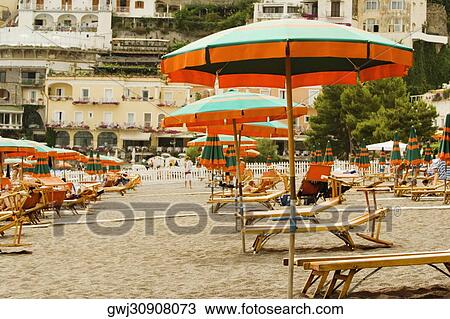 Magnificent Lounge Chairs With Beach Umbrellas On The Beach Spiaggia Ncnpc Chair Design For Home Ncnpcorg