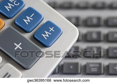 Stock Images Of Mathematical Symbols On A Calculator And A Computer