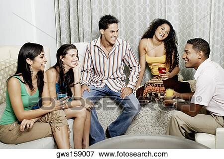 picture of group of friends talking to each other and smiling
