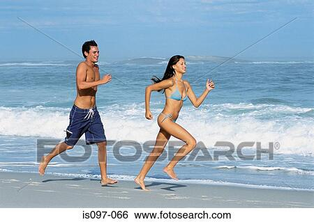 Stock Image Woman And Man Jogging On The Beach Fotosearch Search Photography