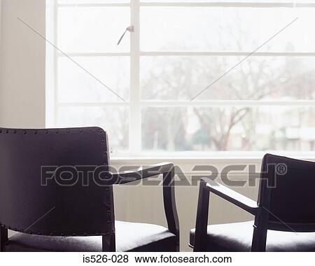 Picture Two Leather Chairs Opposite A Window Fotosearch Search Stock Photos Images