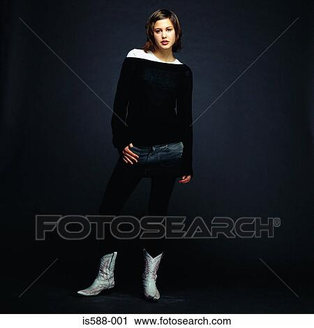 Stock Photography Of Young Woman Wearing Cowboy Boots Is588 001