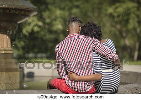Rear view of young couple, Bethesda fountain, Central Park, New York City,  USA Stock Image