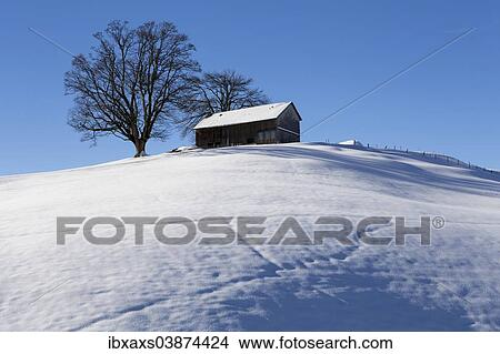 An Appenzell Farmhouse On A Snow Covered Hill In Winter