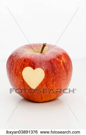 Apple With A Heart Shape Cut Out Stock Photograph