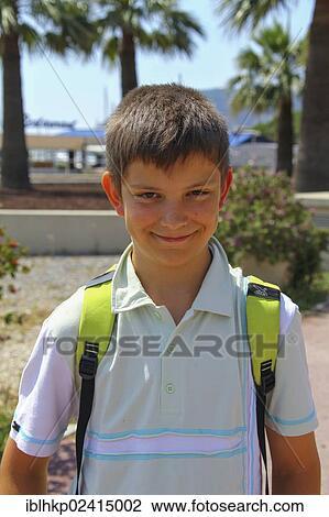 Boy 12 Portrait Wearing A Backpack On A Beach Promenade Mandelieu La Napoule Cote D Azur France Europe Stock Image Iblhkp02415002 Fotosearch