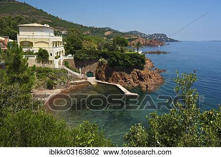 House And Beach In A Small Calanque Bay