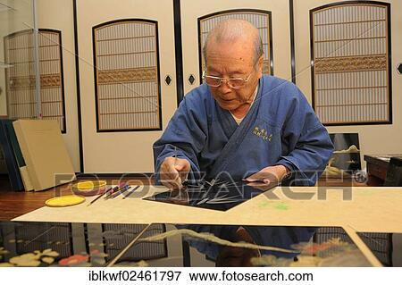 Japanese Artisan In His Workshop Scraping A Bamboo Motif Into The Top Lacquer Coat Sabae Fukui Japan East Asia Asia Stock Photo Iblkwf02461797 Fotosearch