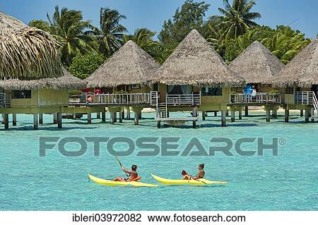 Paddlers In Front Of Overwater Bungalows Bora Bora French