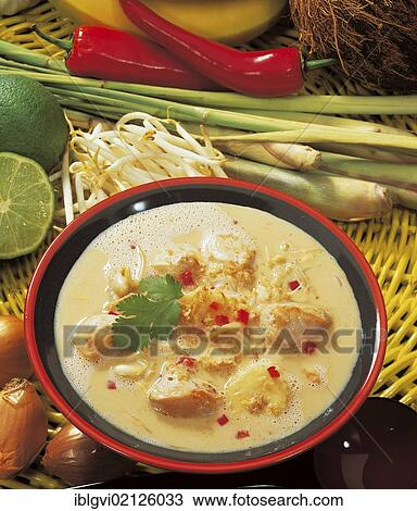 Indonesian coconut soup with exotic spices and ingredients, with tender  chicken breast, Indonesia, Asia Stock Image