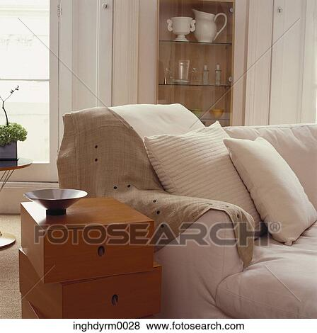 Pleasant Close Up Of A Asymmetrical Side Table Beside A Couch Stock Squirreltailoven Fun Painted Chair Ideas Images Squirreltailovenorg