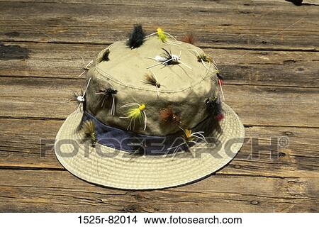69053e040dd12 Fishing hat covered with fishing lures Picture   1525r-82014 ...