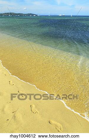 Footprints On The Golden Sand Of Pampelonne Beach Near St Tropez In