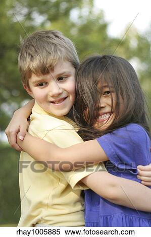 stock image of girl hugging boy rhay1005885 search stock photos